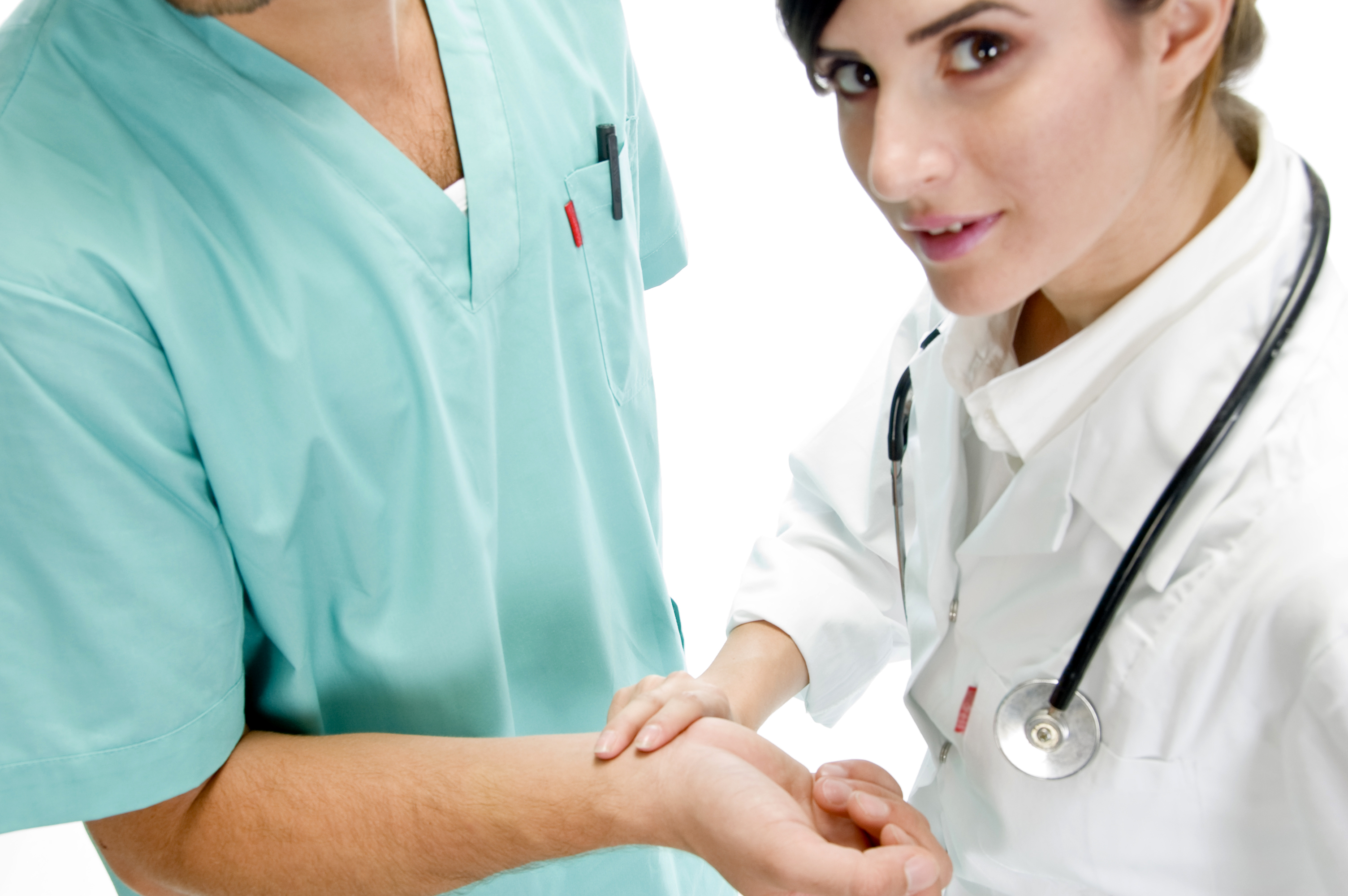 young nurse checking pulse of patient